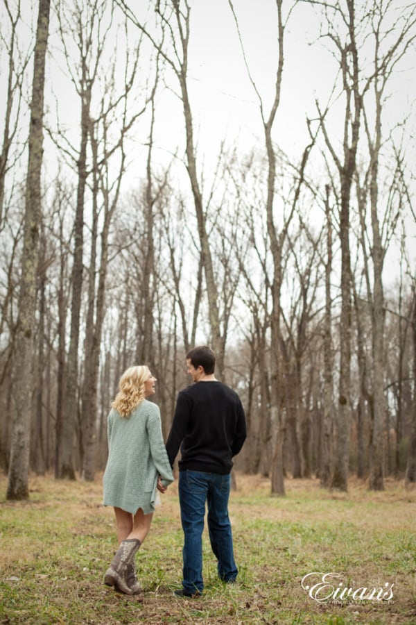 The Laughing and smiling of the couple as they walk and talk in the beautiful forest.