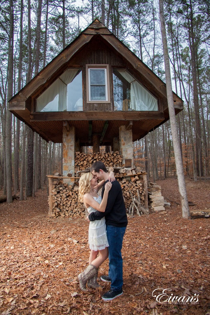 In front of a beautiful small cottage this couple stares into one another's eyes for what is the beginning of a long life together. The rustic beauty of the cottage completely encompassed the fall environment.