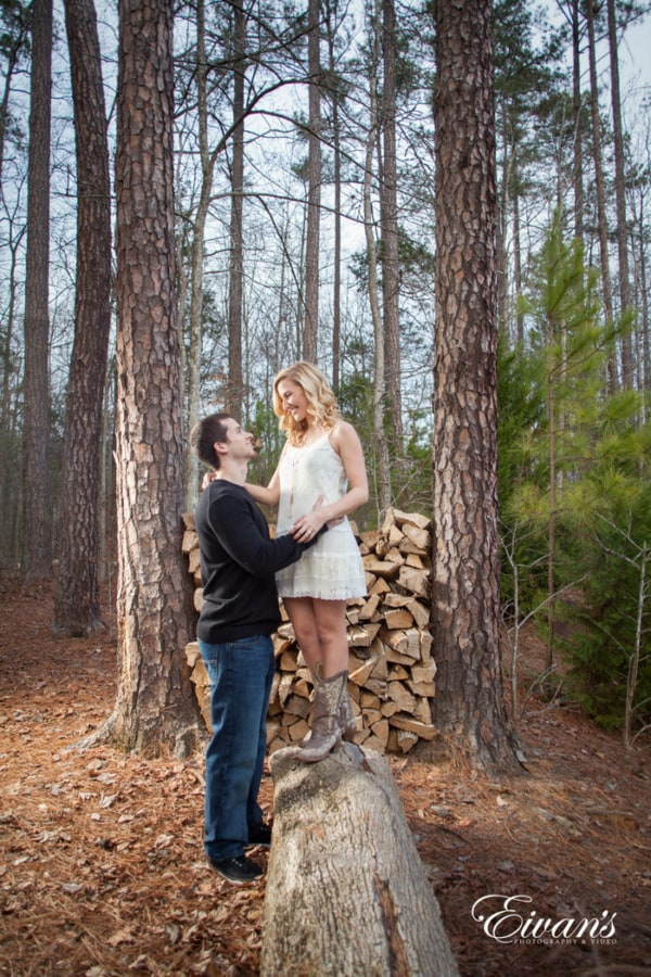 Standing upon a log with nothing but their love filling the air completely. The fall colors make the couple jump out with pure beauty.