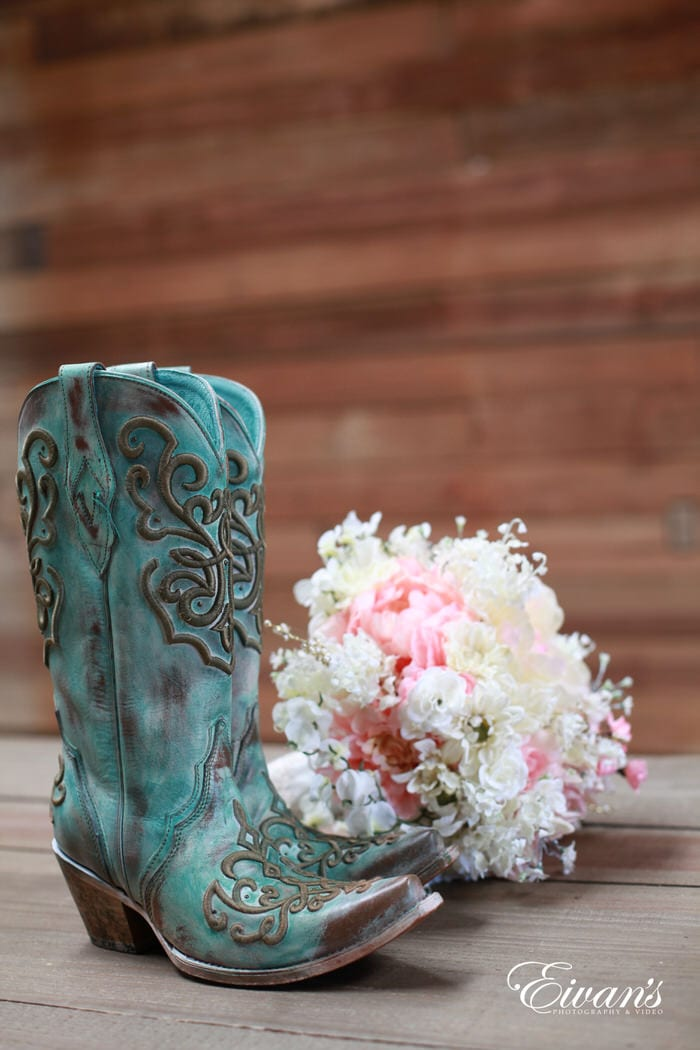 These are the fabulous mint green boots that the bride wears complemented by her pink and white rose boutique.