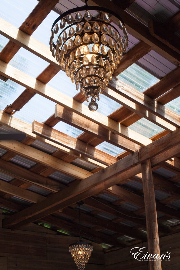 The wooden beams are rustic with beautiful and decorated chandeliers.