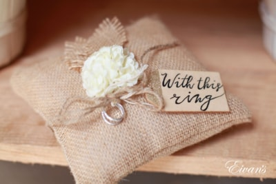 This is a cute and lovely little pillow with a rustic look holding the couple's rings.