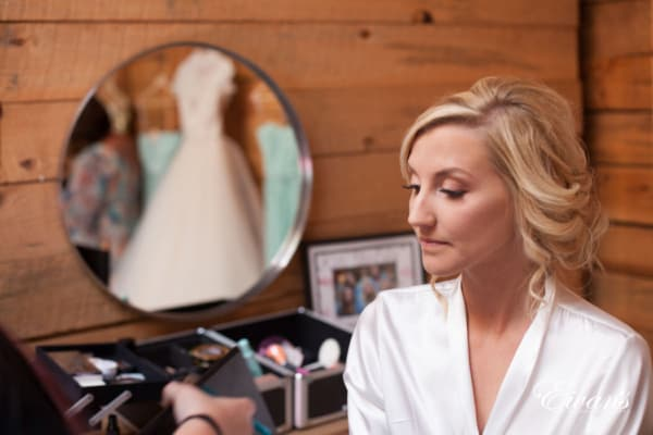 The bride looks absolutely exquisite while she gets her makeup done for the biggest moment in her life.