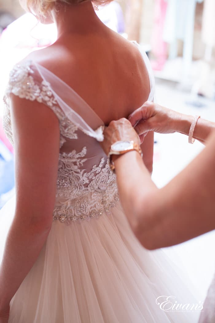 This photograph captures the intricate and beauty of the bride's princess gown.