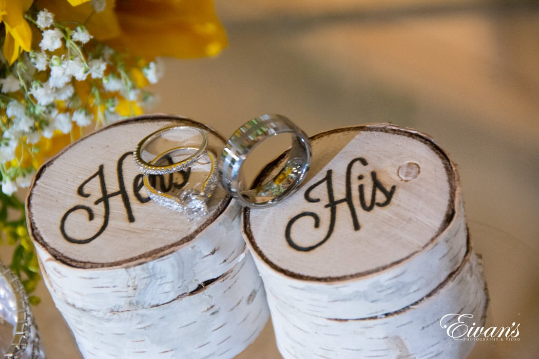 Small ring box that is in the shape of natural log pieces that not only hold the rings the couple will wear forever but also demonstrate their love.