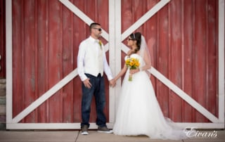 This rustic barn helps complete this couples homey themed wedding while they gaze ever so effortlessly into one another's dreamy eyes.