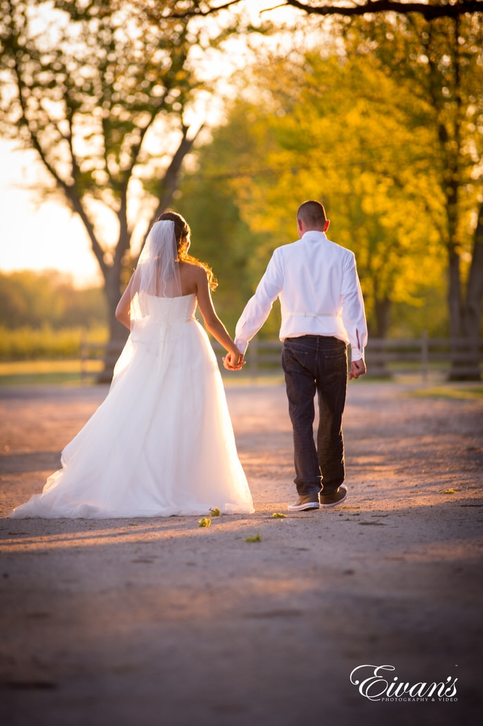 Walking so elegantly while the sunsets on this couple's perfect day only true love and pure happiness fill the air.