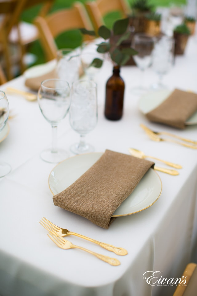 brown leather long wallet on white table