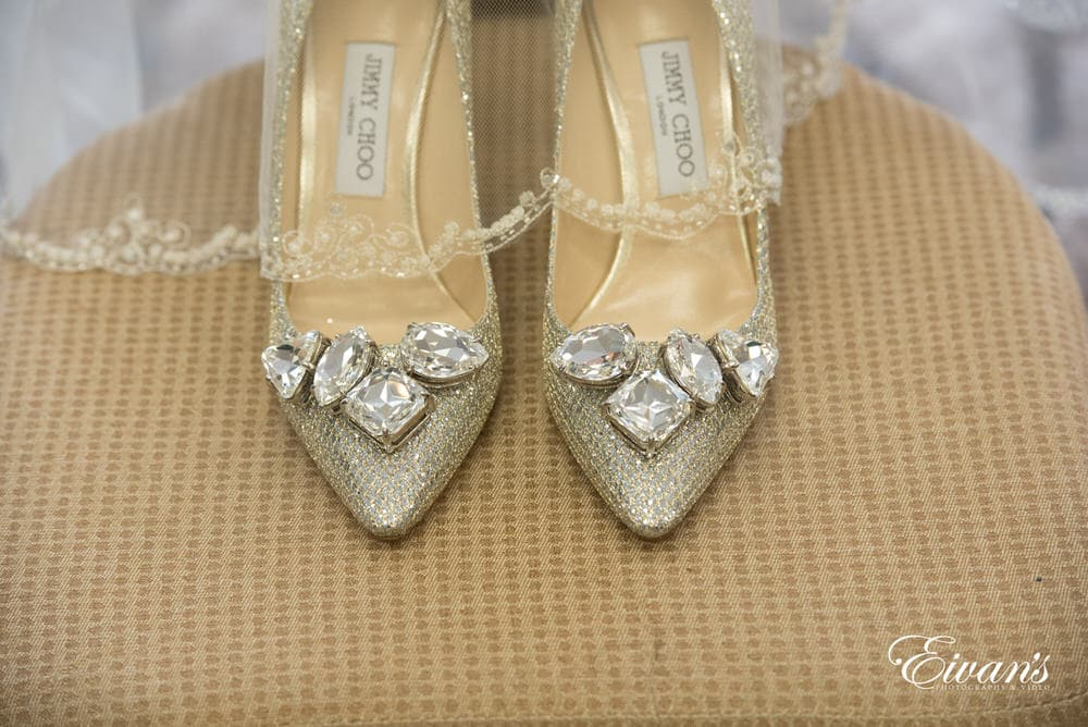 The bride's amazing silver heels are decorated with large and stunning rhinestones.