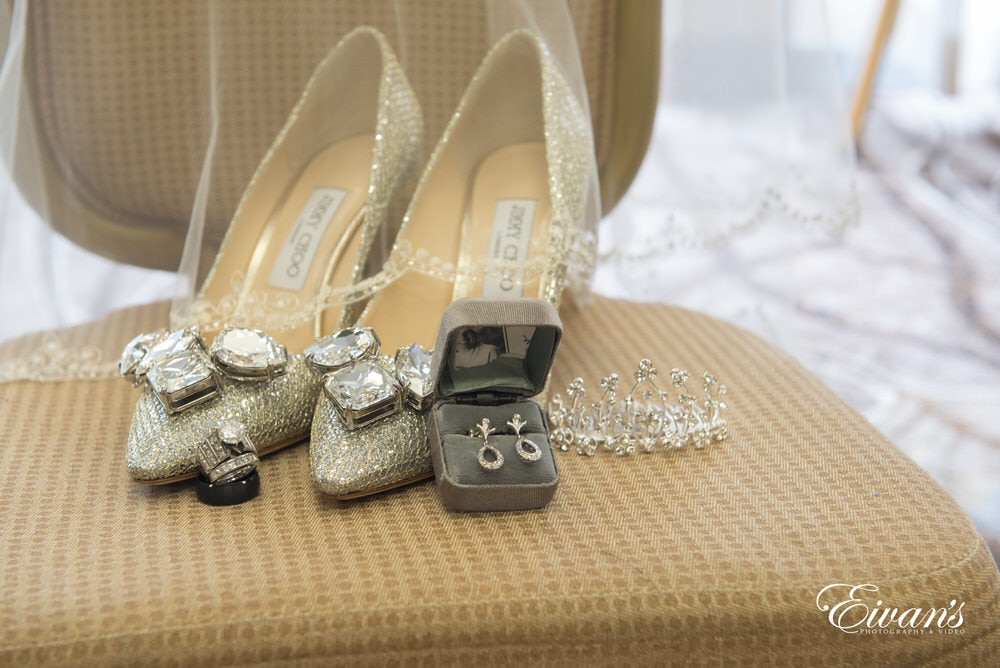 All of the bride's accessory are placed together in one singular location.