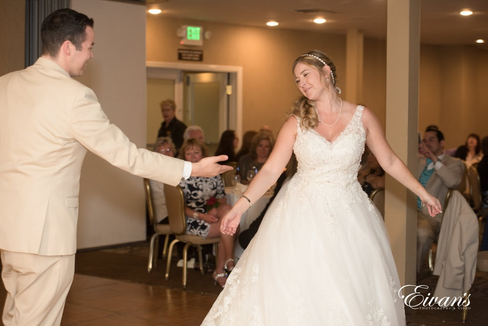 The couple dance together on their perfect fairytale wedding day.