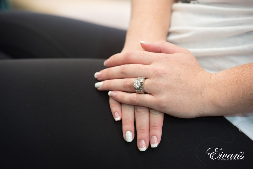 The bride wears her sparkling engagement ring as she prepares for this tremendous day.