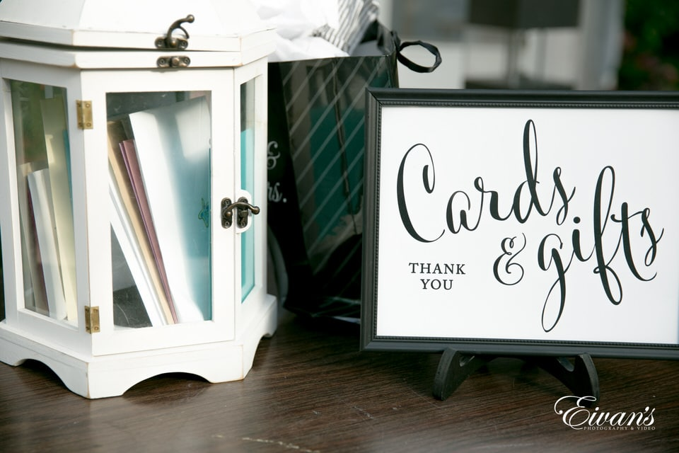 A thank you card example along with a small chest of stationary paper products.