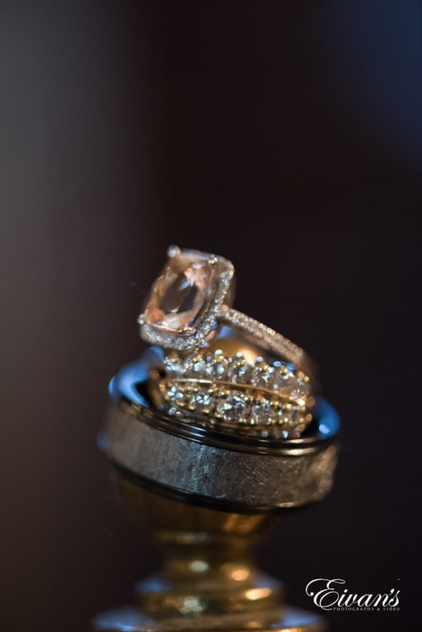 The photographer stacked the rings and wedding bands atop one another for a beautiful detail shot.