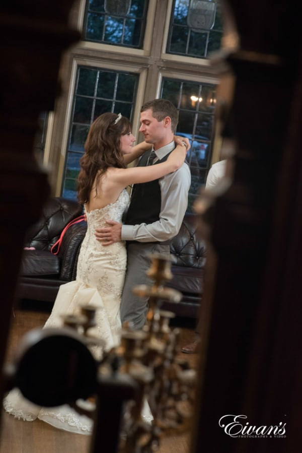 Candid photography of bride and groom dancing in an old-fashioned home.