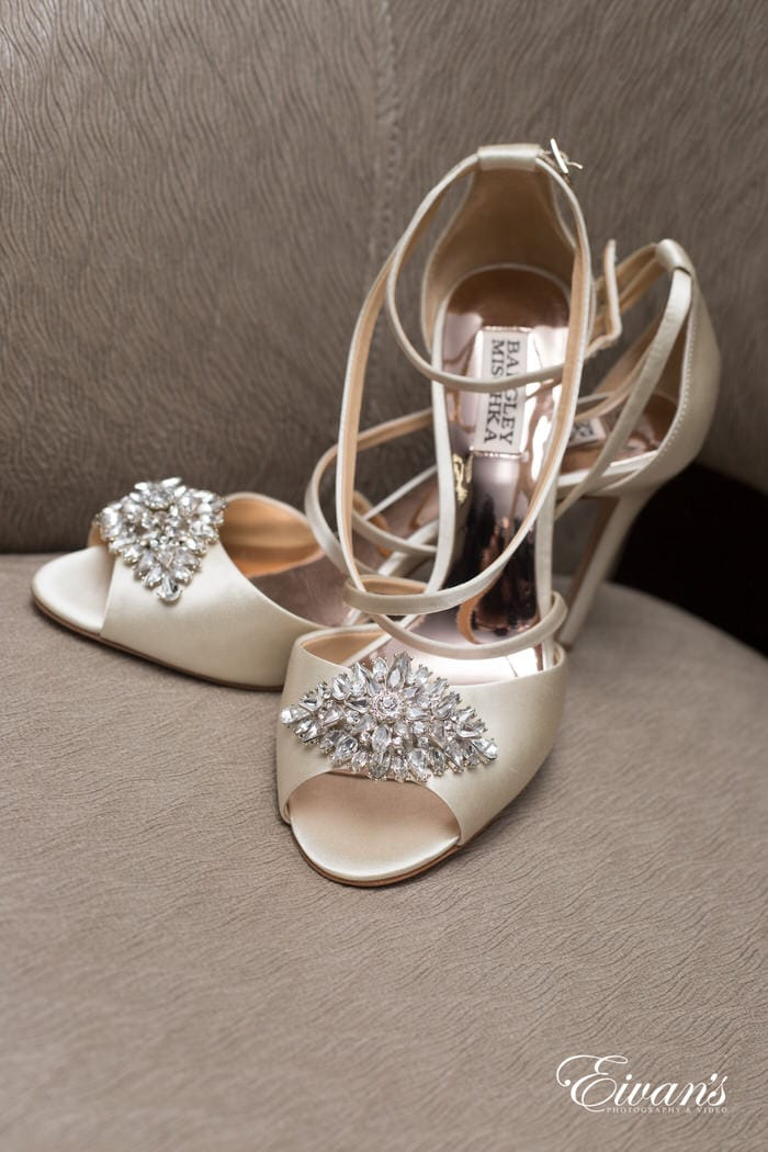 These champagne heels with intricate rhinestone pieces help entirely pull together the bride's look.