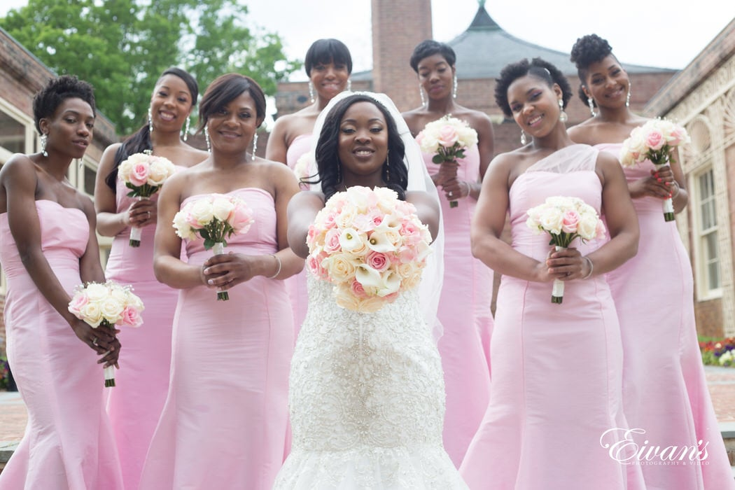 With the smiling gazes from the bride and bridesmaids as they show off their stunning bouquets.