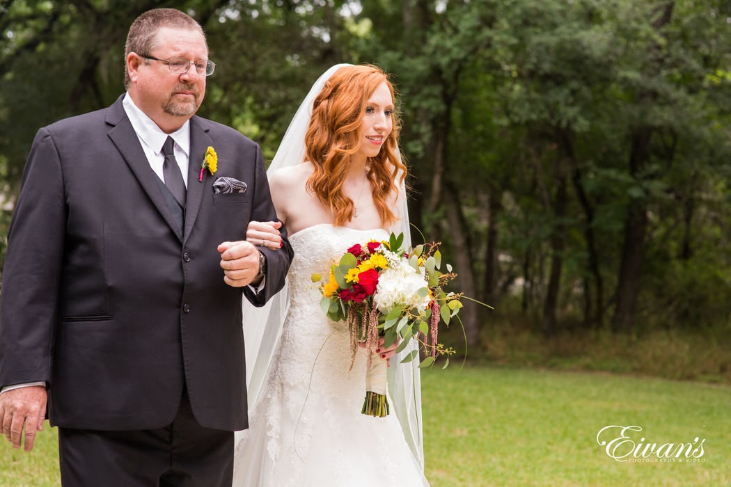 The bride's father walked his baby girl to the love of her life, handing her off to the next important man in her life.