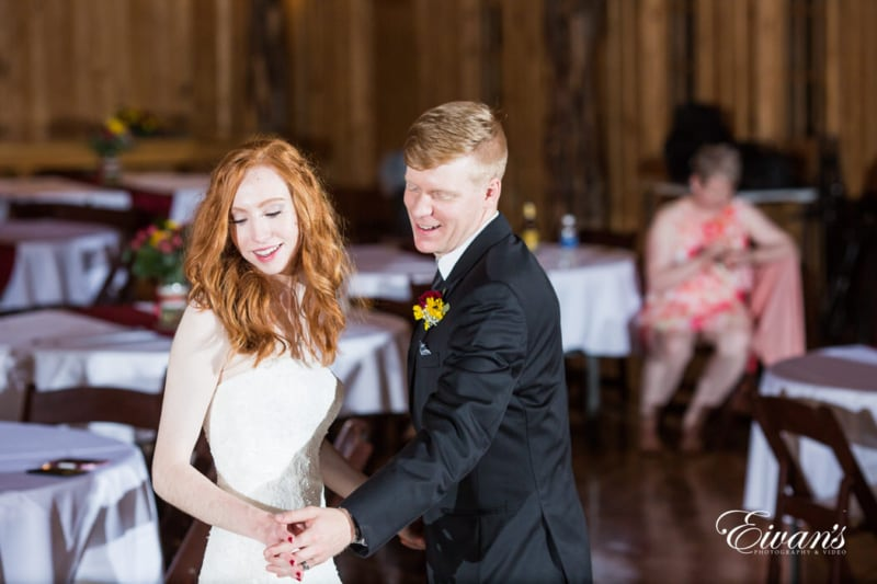 During this first dance the couple gaze around the room in the moment of love and happiness.