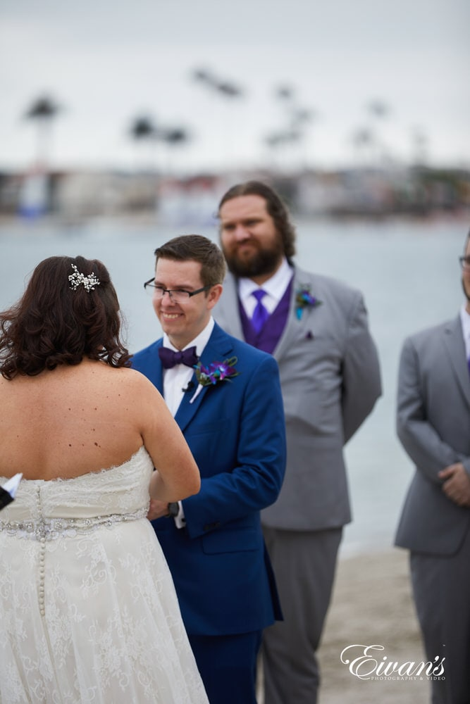 The groom gazes into the love of his life's eyes during the ceremony.