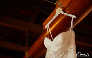 The hanger holding the bride's gown has her soon-to-be new last name.