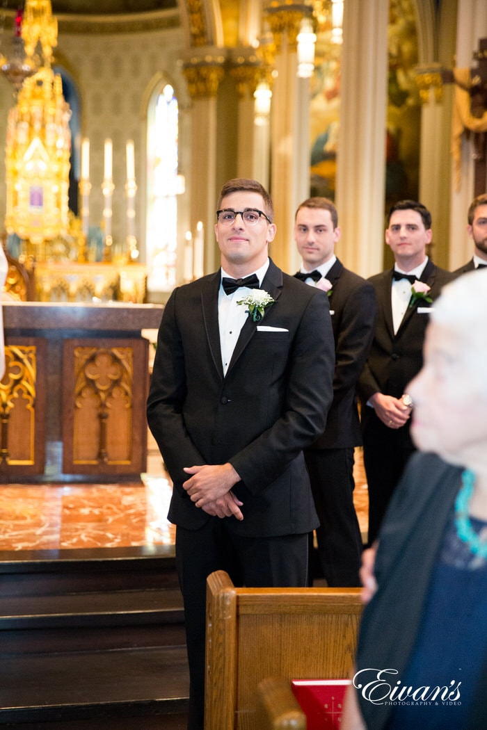 Max stands at the end of the alter waiting for his gorgeous bride so they can finally be one working team. The beautiful embellishments within this exquisite chapel.