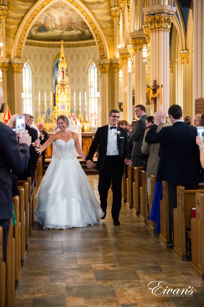 The smiling couple beams excitedly as they walk out of the stunning chapel. Seconds after they finally solidified their love to one another they smiled and hugged their friends and family with the amazing news.