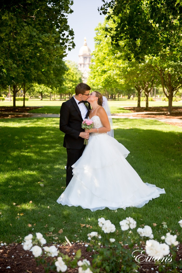 These lush greens only help and draw attention to this couple's blooming love and everlasting hope.