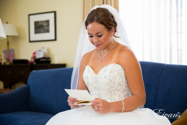Reading the letter from her husband before they do solidify their vows.