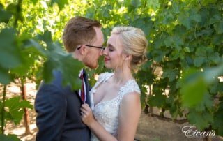 Gazing into one another's eyes while standing in the vineyard that only helps encompass their love and time.