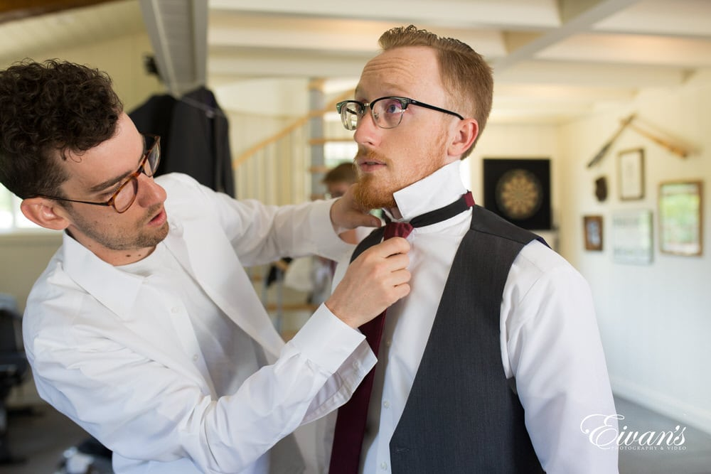 The groom's little helpers help to place the ensemble the tie to the rest of his look.