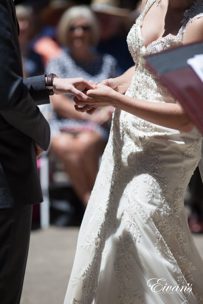 The couple place rings on each other's hands just for the soul purpose of constantly proclaiming their love.