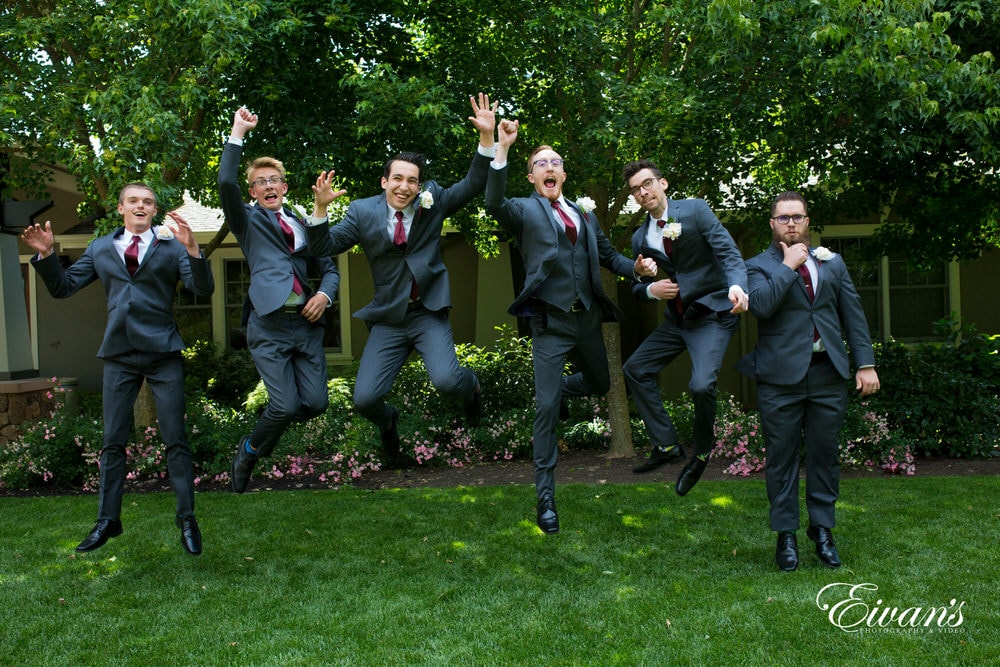 Jumping into this new life, the groom and groomsmen celebrate lots.