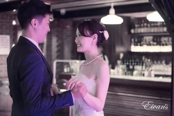 Smiling while having their first dance and feeling the true and raw emotions.