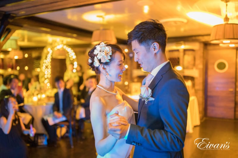The couple dances together in a beautiful winery feeling the love in the air.