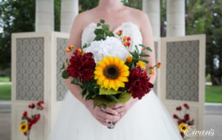 The bride's stunning bouquet is very bright and vibrant and entirely captures their perfect moment.