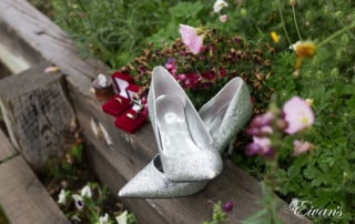 The bride's rings and heels are so decorated in such an amazing ensemble.