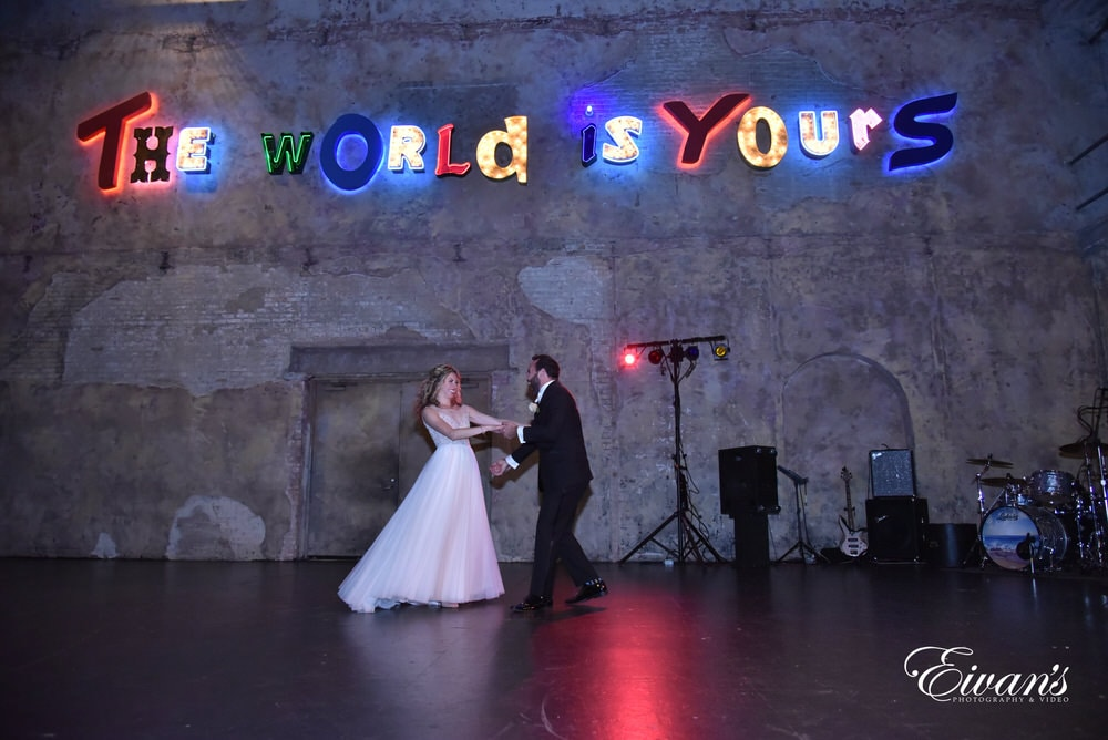 The couple dance together while having their first moments together in this spotlight for their friends and family to see.