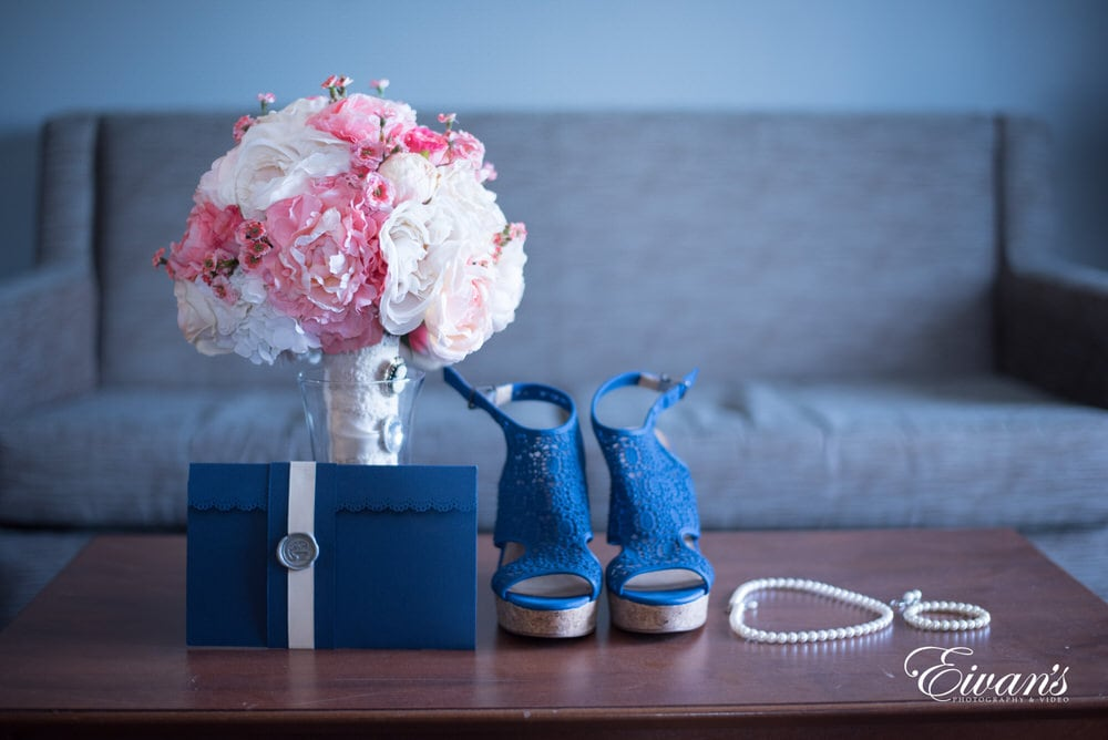 The bride's bouquet and accessories are all placed out delicately ready for the bride's special day.