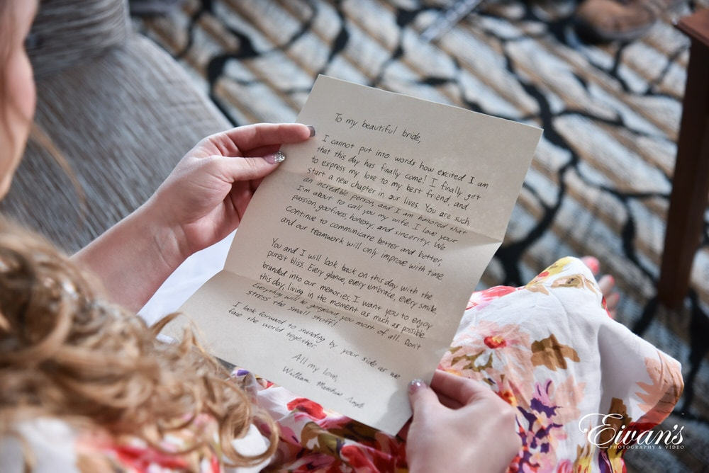 The bride reads a beautiful handwritten note from her dearly beloved.