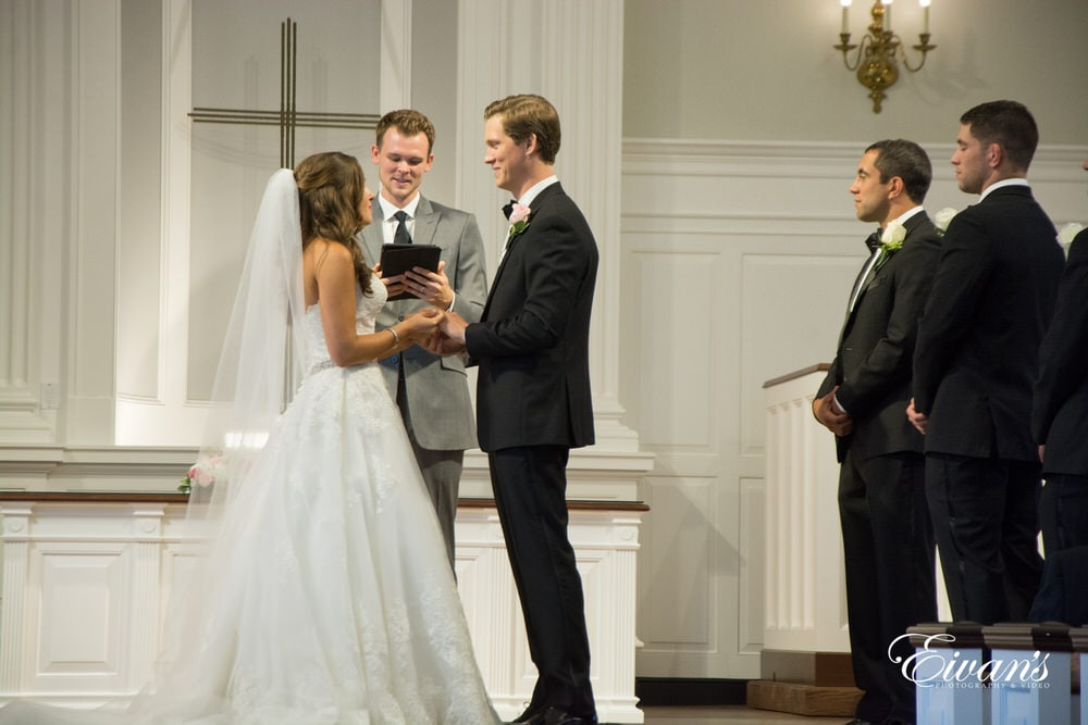 The couple say their vows to one another as they give in to one another for the rest of their lives.