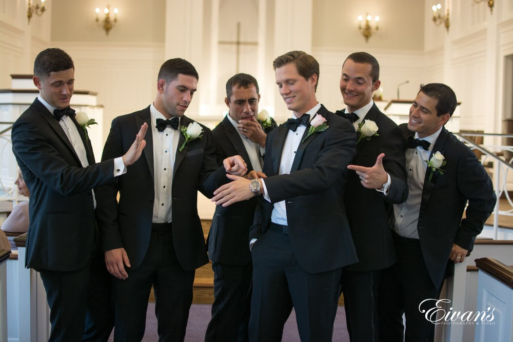 The groom shows off the gift from the love of his life to all of his closest friends
