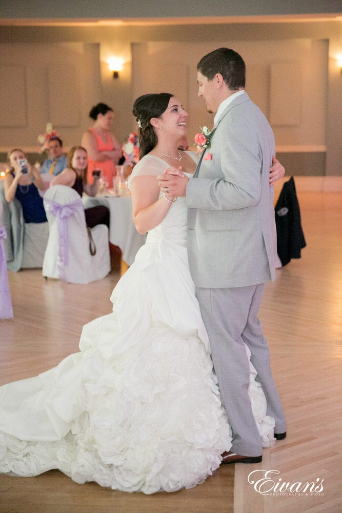 The couple share their first dance together as a married couple in front of their loving friends and family.