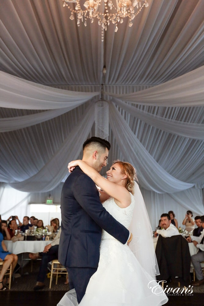 The bride and groom share their first dance as a married couple together.