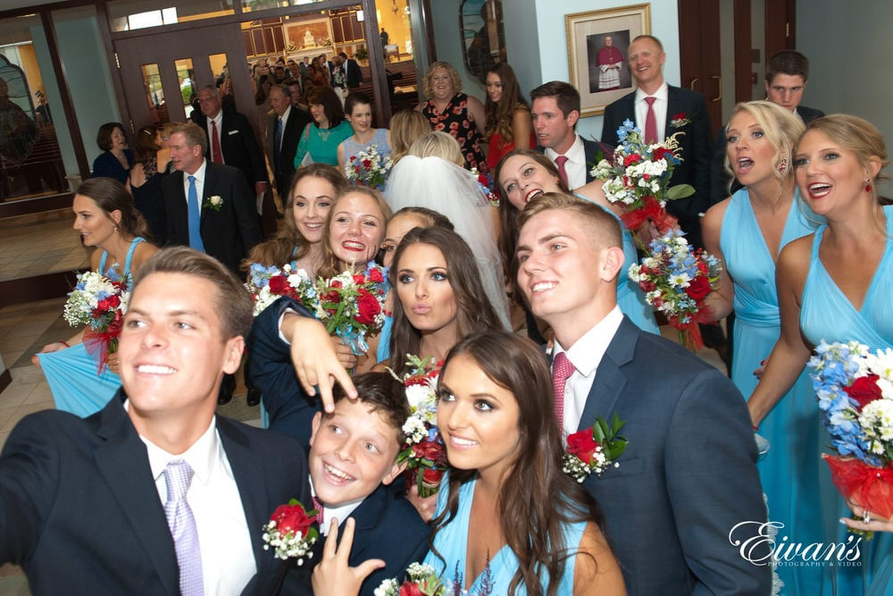 The couple's counterparts take a selfie to remember this moment for the rest of their life's.