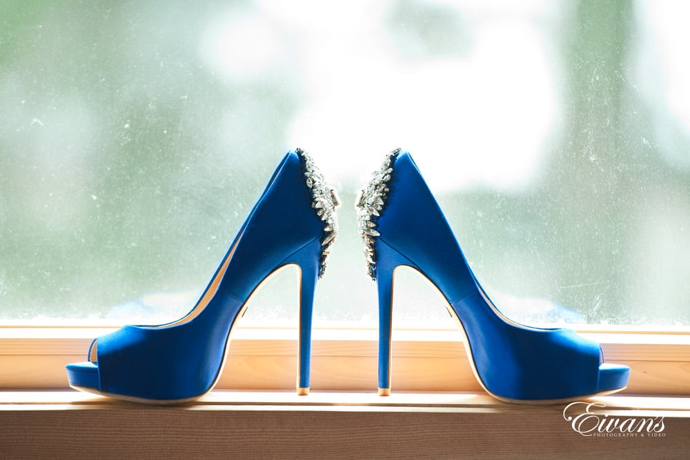 These blue heels are beautifully set with her amazing white bridal gown.