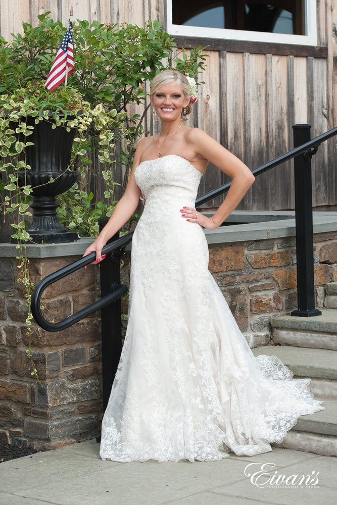 The bride stands ever so effortlessly in her perfect wedding attire.