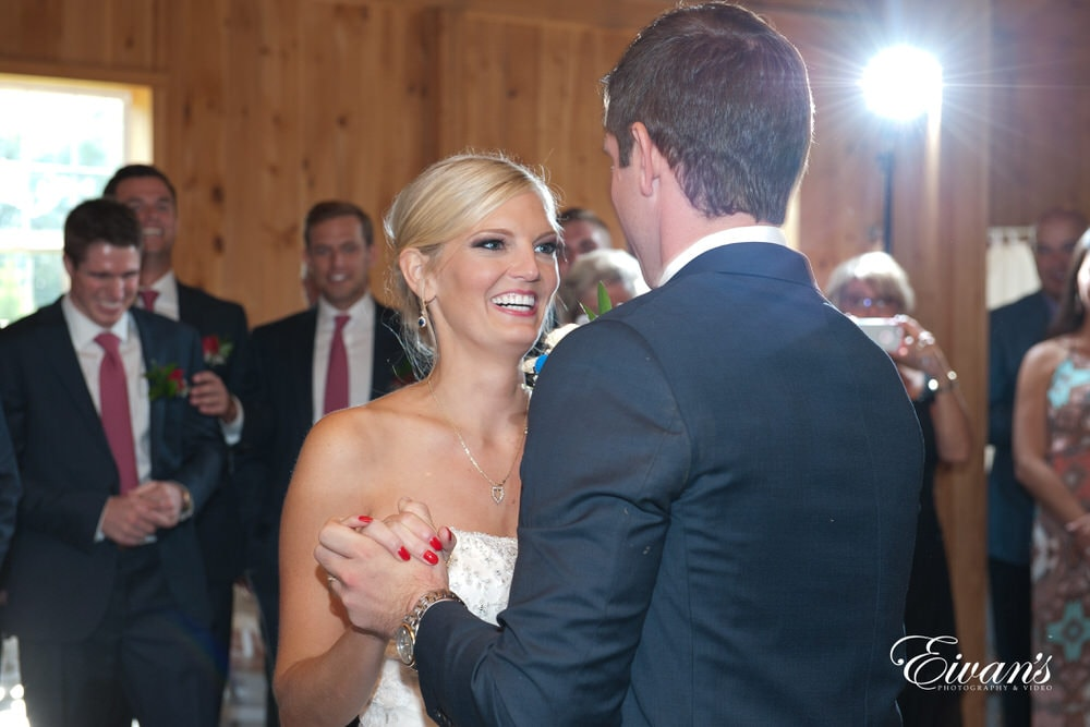 The bride smiles while looking into her dearly beloved eyes for a moment that makes everything feel so ever perfect.