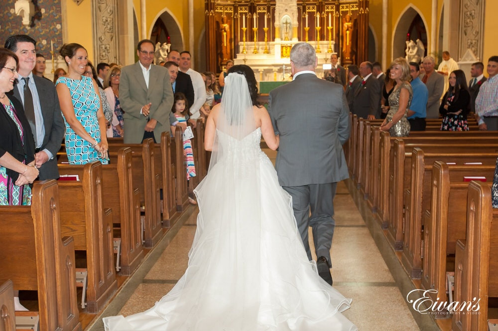 Being walked to the alter to marry the love of her life in the perfect catholic church.