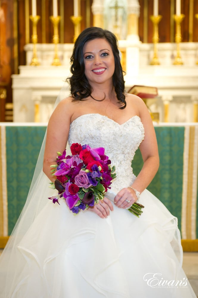 The bride stands ever so effortlessly stunning in the halls of this beautiful church.